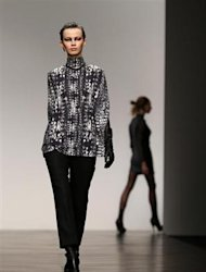 A model presents a creation from the Aminaka Wilmont Autumn/Winter 2013 collection during London Fashion Week, February 19, 2013. REUTERS/Suzanne Plunkett