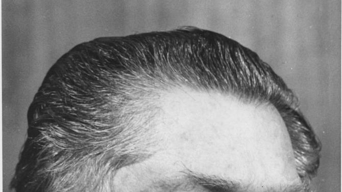 FILE - Jimmy Hoffa is shown in this 1975 file photo. Hoffa, father of current Teamsters President James P. Hoffa, disappeared from the parking lot of the Machus Red Fox restaurant in Oakland County's Bloomfield Township in July 1975. Federal agents revived the hunt for the remains of Jimmy Hoffa on Monday June 17, 2013, digging around in a suburban Detroit field where a reputed Mafia captain says the Teamsters boss' body was buried. (AP Photo/Richard Sheinwald)