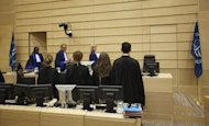<p>Judges enter court for the closing statements in the trial of Congolese former millitia chiefs Germain Katanga and Mathieu Ngudjolo Chui at the International Criminal Court (ICC) in The Hague on May 15, 2012.</p>