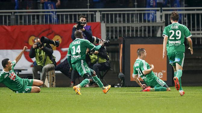 Hamouma of Saint-Etienne reacts with teammates after scoring against Olympique Lyon during their French Ligue 1 soccer match in Lyon