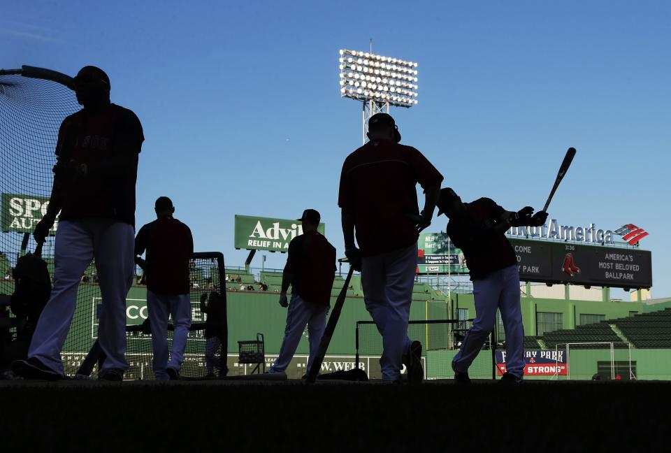 Boston Red Sox players wait to take batting practice during baseball practice Monday, Oct. 21, 2013, in Boston. The Red Sox are preparing to play the St. Louis Cardinals in Game 1 of the World Series on Wednesday. (AP Photo/Charlie Riedel)