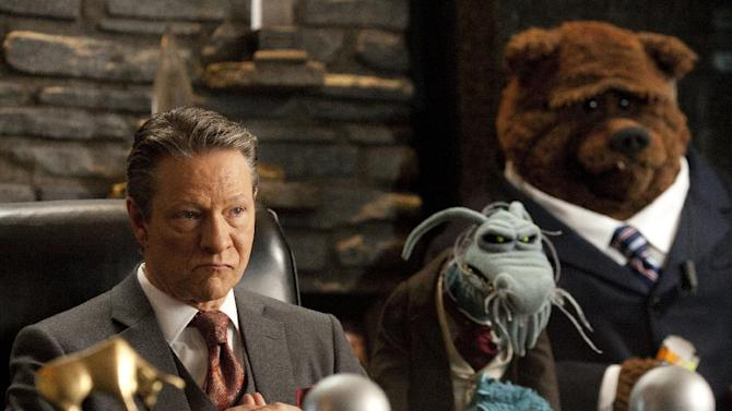 "In this film image released by Disney Enterprises, actor Chris Cooper portrays evil oil man Tex Richman in a scene from ""The Muppets."" (AP Photo/Disney, Scott Garfield)"