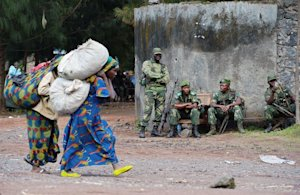 Congolese women walk past Democratic Republic of Congo …