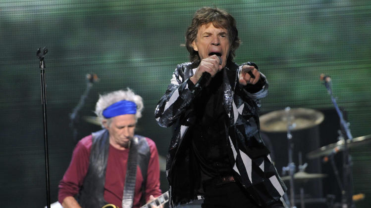 "Mick Jagger, right, and Keith Richards of the Rolling Stones perform at the kick-off of the band's ""50 and Counting"" tour at the Staples Center on Friday, May 3, 2013 in Los Angeles. (Photo by Chris Pizzello/Invision/AP)"