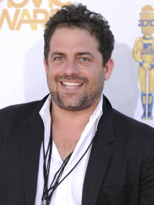 """FILE - In this June 6, 2010 file photo, Director Brett Ratner arrives at the MTV Movie Awards in Universal City, Calif. Ratner resigned as a producer of the 84th annual Academy Awards on Tuesday, Nov. 8, 2011. Ratner aplogized Monday for using a gay slur during a question-and-answer session at a screening for his new film, """"Tower Heist."""" (AP Photo/Chris Pizzello, File)"""