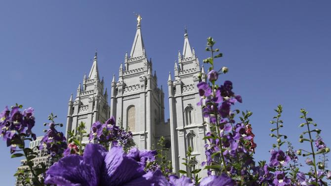 FILE - This Sept. 3, 2014, file photo shows flowers blooming in front of the Salt Lake Temple, at Temple Square, in Salt Lake City. The Mormon church is taking another step in its push to be more transparent, and is releasing more historical documents that shed light on how Joseph Smith formed the religion. The Church of Jesus Christ of Latter-day Saints says the volume being scheduled to be released at a news conference Wednesday in Salt Lake City is a printer's manuscript of the Book of Mormon. (AP Photo/Rick Bowmer, File)