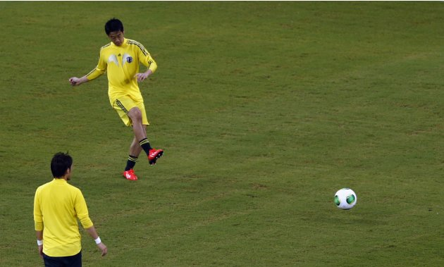 Japan's Shinji Kagawa kicks the ball during a training session at the Arena Pernambuco stadium in Recife