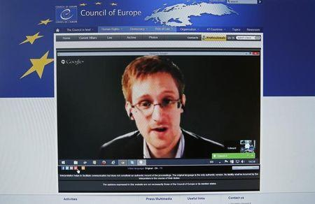 Accused government whistleblower Snowden is seen on the computer screen of a journalist as he speaks via video conference with members of the Committee on legal Affairs and Human Rights of the Parliamentary Assembly of the Council of Europe in Strasbourg