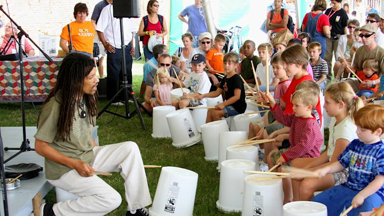 This photo courtesy of the National Folk Festival shows Ram Bhagat, of Drums No Guns, as he performs with young participants at the 2008 National Folk Festival in Richmond, Va. This year, the National Folk Festival will be in Nashville, Tenn. The festival has been produced since 1934 by the National Council for the Traditional Arts.    (AP Photo/National Folk Festival)