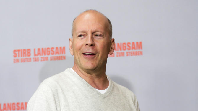 US actor Bruce Willis poses during a photo call to promote the movie 'A Good Day to Die Hard' in Berlin, Tuesday, Feb. 5, 2013. (AP Photo/Markus Schreiber)