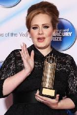 Adele holds her award at the Barclaycard Mercury Music Prize 2011 at the Grosvenor House, London, Sept. 6, 2011 -- Getty Images