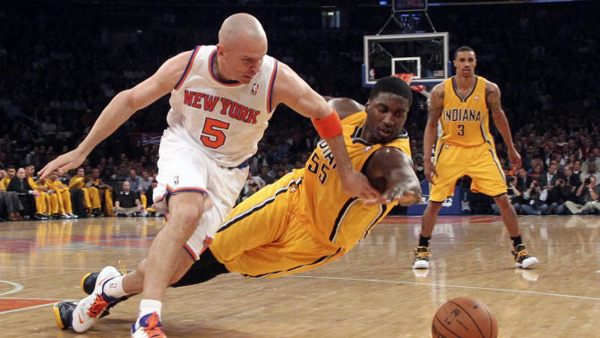 New York Knicks' Jason Kidd (5) and Indiana Pacers' Roy Hibbert dive for a loose ball in the first half of Game 2 of their NBA basketball playoff series in the Eastern Conference semifinals at Madison Square Garden in New York, Tuesday, May 7, 2013. (AP Photo/Mary Altaffer)