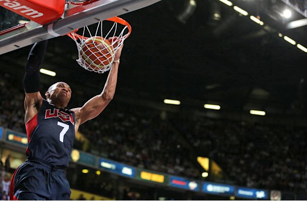 Russell Westbrook of the USA scores during an Olympic Warm Up match at the Manchester Arena, in Manchester, England, Thursday July 19, 2012.  Competitors from around the globe are arriving in London t