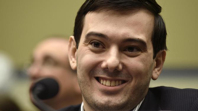 "FILE - In this Feb. 4, 2016 file photo, Pharmaceutical chief Martin Shkreli smiles on Capitol Hill in Washington during the House Committee on Oversight and Reform Committee hearing on his former company's decision to raise the price of a lifesaving medicine.  Former pharmaceutical CEO and government target Martin Shkreli continues his attempts to build up his music collection. After spending $2 million for the sole copy of Wu-Tang Clan's ""Once Upon a Time in Shaolin."" The 32-year-old former hedge fund manager is now offering $10 million for Kanye West's new album. (AP Photo/Susan Walsh)"