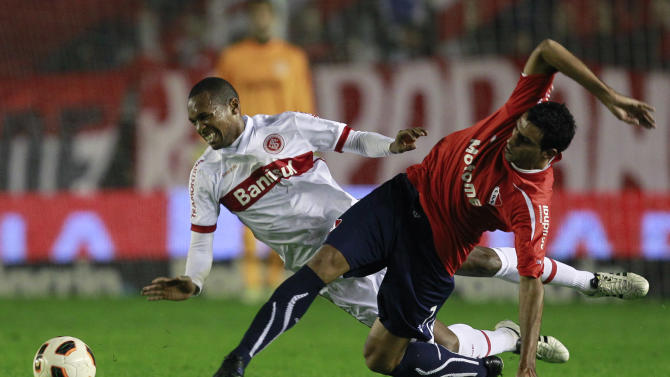 Brazil's Internacional's Wilson Mathias, left, fights for the ball against Argentina's Independiente's Cristian Pellerano, right, during a Recopa Sudamericana first leg soccer match in Buenos Aires, Argentina, Wednesday, Aug. 10, 2011. (AP Photo/Victor R. Caivano)