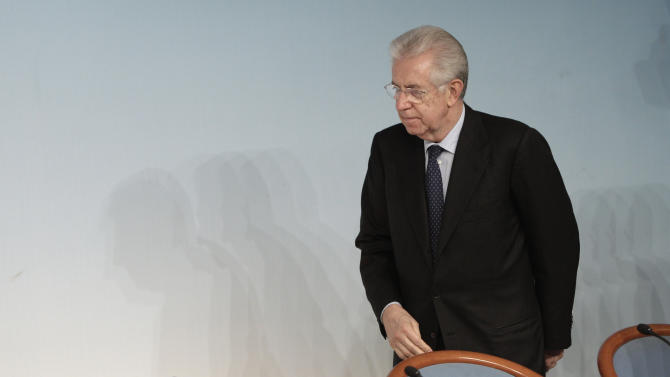 FILE -- In this file photo taken at Chigi Palace government's office in Rome, on  Dec. 6, 2012, Italian Premier Mario Monti gestures arrives for a news conference at the end of a cabinet meeting. Premier Mario Monti told the Italian president Saturday, Dec. 8, 2012, he plans to resign following the sudden loss of support from Silvio Berlusconi's party, paving the way for early elections a year after the economist helped pull the country back from the brink of financial disaster. (AP Photo/Riccardo De Luca)