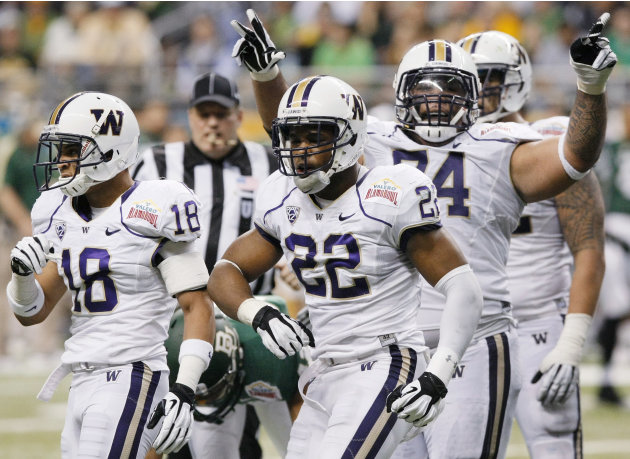 Washington's Josh Shirley, center, Gregory Ducre, left, and Alameda Ta'amu celebrate a sack during the first half of the Alamo Bowl college football game against Baylor, Thursday, Dec. 29, 2011, at th
