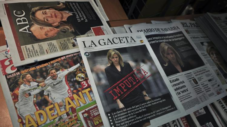 "Spanish newspapers feature front page coverage of Spain's Princess Cristina de Borbon and her summoning to court as a suspect in a corruption case, in Pamplona northern Spain, Thursday, April 4, 2013. Spain's foreign minister said Thursday there was ""enormous concern"" within the government over the naming of one of the king's daughters as a suspect in a corruption case. (AP Photo/Alvaro Barrientos)"