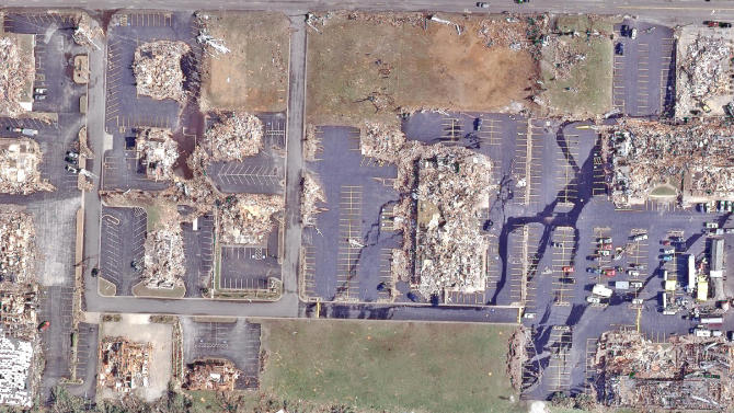 This image provided by GeoEye shows, some the destruction in an area of Joplin, Mo. Tuesday May 24, 2011, two days after a devastating tornado tore through the city, killing at least 122 people. (AP Photo/GeoEye)