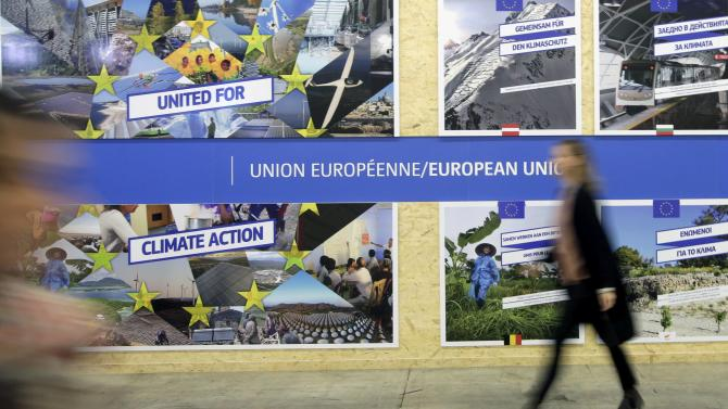 A visitor walks past the European Union pavilion during the World Climate Change Conference 2015 at Le Bourget, near Paris
