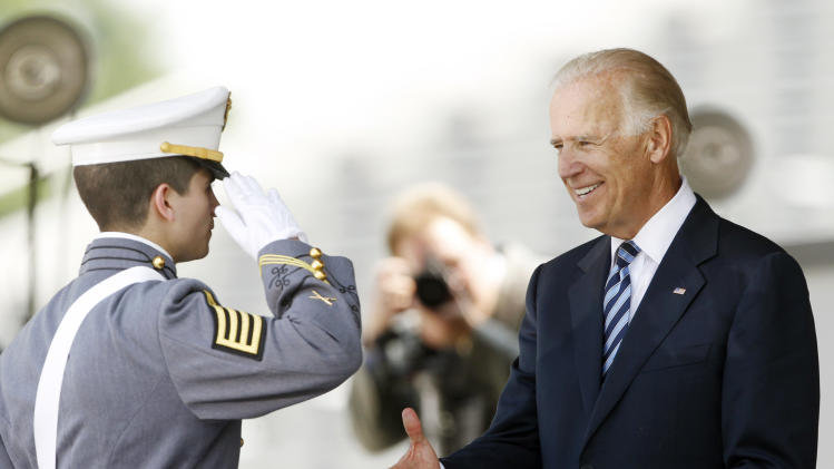 Vice President Joe Biden presents a diploma to valedictorian Alexander George Pagoulatos during a graduation and commissioning ceremony at the U.S. Military Academy in West Point, N.Y., on Saturday, May 26, 2012. (AP Photo/Mike Groll)