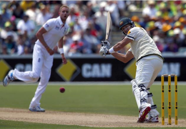 England's Broad watches as Australia's Watson hits a four during the first day's play in the second Ashes test in Adelaide