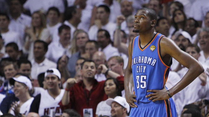 Oklahoma City Thunder small forward Kevin Durant (35) looks at the scoreboard during the second half at  Game 5 of the NBA finals basketball series against the Miami Heat, Thursday, June 21, 2012, in Miami. (AP Photo/Lynne Sladky)