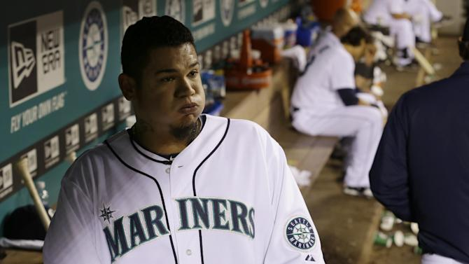 Seattle Mariners starting pitcher Felix Hernandez reacts in the dugout after finishing the eighth inning of a baseball game against the Detroit Tigers, Wednesday, April 17, 2013, in Seattle. (AP Photo/Ted S. Warren)