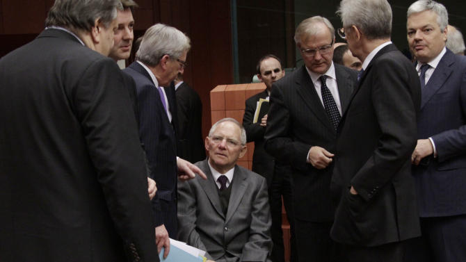 From left, Greek Finance Minister Evangelos Venizelos, French Finance Minister Francois Baroin, Luxembourg's Prime Minister Jean-Claude Juncker, German Finance Minister Wolfgang Schaeuble, European Commissioner for the Economy Olli Rehn, Italian Prime Minister and Finance Minister Mario Monti and Belgium's Finance Minister Didier Reynders share a word during a round table meeting of the eurogroup at the EU Council building in Brussels on Tuesday, Nov. 29, 2011. The 17 finance ministers of countries that use the euro converged on EU headquarters Tuesday in a desperate bid to save their currency and to protect Europe, the United States, Asia and the rest of the global economy from a debt-induced financial tsunami. (AP Photo/Virginia Mayo)