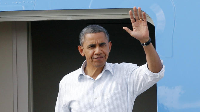 President Barack Obama waves as he arrives at Louis Armstrong New Orleans International Airport in Kenner, La., Monday, Sept. 3, 2012. (AP Photo/Jonathan Bachman)