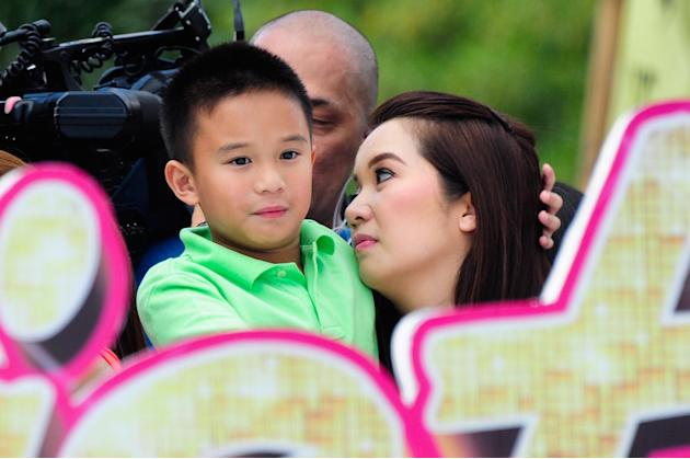 """Queen of All Media"" Kris Aquino is seen at the float of the MMFF entry ""Sisterekas"" with son Bimby during the 2012 Metro Manila Film Festival Parade of Stars on 23 December 2012.(Angela Galia/NPPA Im"