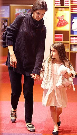 Katie Holmes and daughter Suri hit the American Girl store in New York City. Splash News