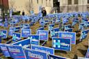 A group of signs for Democratic presidential candidates Bernie Sanders and Hillary Clinton shows a tightening nomination race before the start of the debate on January 17, 2016 in South Carolina