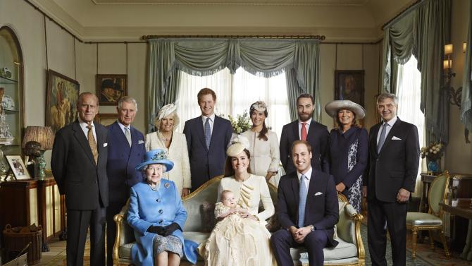 This image made available by Camera Press shows the official christening photo of Britain's Prince George photographed in the Morning Room at Clarence House in London on Wednesday Oct. 23, 2013. Kate Duchess of Cambridge holds her son Prince George seated next to Queen Elizabeth II and Prince William, back row from left, Prince Philip, Prince Charles, and the Duchess of Cornwall, Prince Harry, Pippa Middleton, James Middleton, Carole Middleton and Michael Middleton. (AP Photo/Jason Bell, Camera Press)