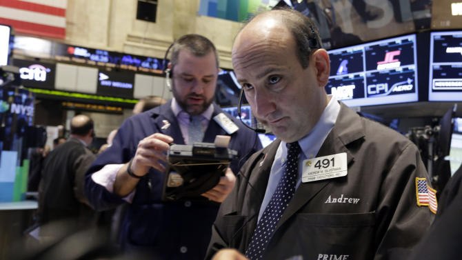 FILE - In this Monday, Jan. 27, 2014, file photo, trader Andrew Silverman, right, works on the floor of the New York Stock Exchange. Stocks are higher in early trading on Wall Street, Tuesday, Jan. 28, 2014, as the stock market turns positive after three days of losses. (AP Photo/Richard Drew, File)
