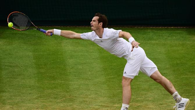 Britain's Andy Murray returns to South Africa's Kevin Anderson during their men's singles fourth round match on day seven of the 2014 Wimbledon Championships at The All England Tennis Club in Wimbledon, southwest London, on June 30, 2014