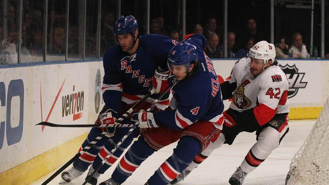 Michael Del Zotto #4 And Dan Girardi #5 Of The New York Rangers Control The Puck Against Jim O'Brien #42 Of The Getty Images