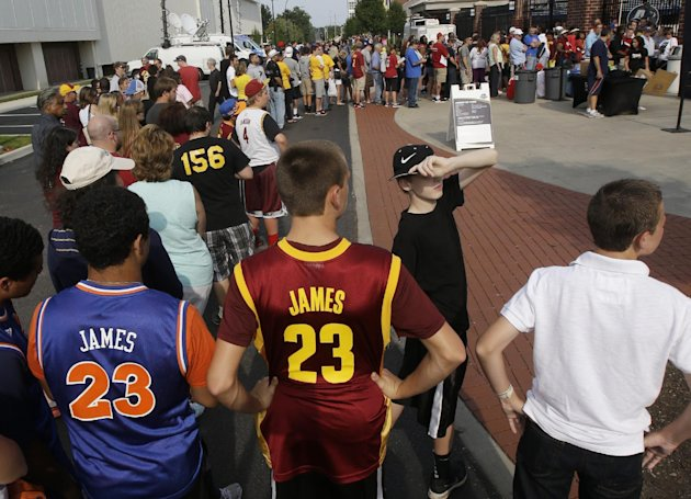 From left to right, Bryce Traylor and Corey Oswald, both 14, wait in line to enter InfoCision Stadium for the LeBron James homecoming Friday, Aug. 8, ...