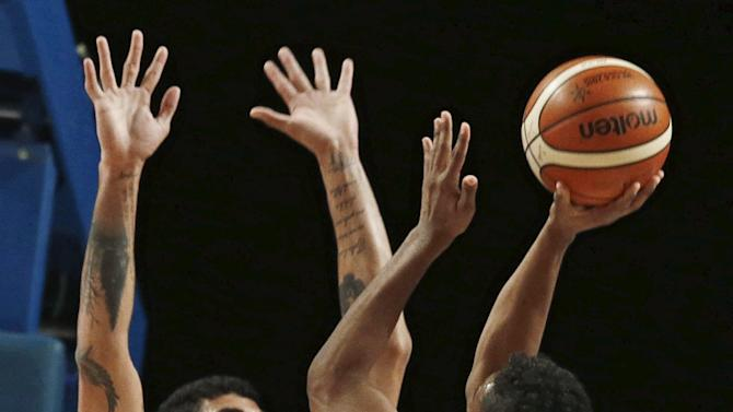 Dominican Republic's Suero goes for the basket against Brazil's Lima during their 2015 FIBA Americas Championship basketball game in Mexico City