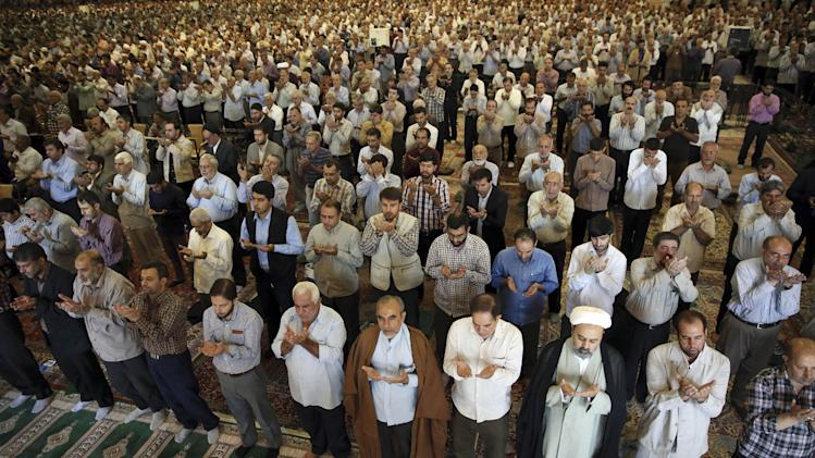 Iranian worshippers perform their Friday prayers at the Imam Khomeini grand mosque in Tehran, Iran, Friday, Aug. 29, 2014. (AP Photo/Vahid Salemi)