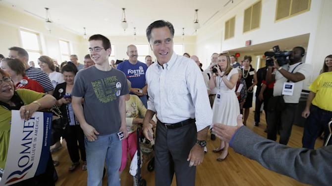 """In this May 30, 2014, file photo, former Republican presidential nominee Mitt Romney greets supporters before speaking at a rally for Iowa Republican Senate candidate Joni Ernst in Cedar Rapids, Iowa. He feared he would be """"a loser for life"""" if he failed to win the presidency, but Romney is trying to re-emerge as a force in Republican politics. (AP Photo/Charlie Neibergall, File)"""