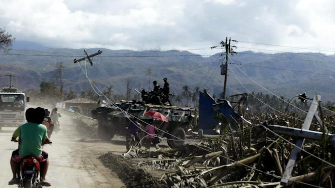 "Commuters pass by a banana plantation that was destroyed at the height of Tuesday's typhoon named ""Bopha"" at Nabunturan township, Compostela Valley in southern Philippines Friday Dec. 7, 2012. The economic losses began to emerge Friday after export banana growers reported that 14,000 hectares (34,600 acres) of export banana plantations, equal to 18 percent of the total in Mindanao, were destroyed. The Philippines is the world's third-largest banana producer and exporter, supplying well-known brands such as Dole, Chiquita and Del Monte mainly to Japan and also to South Korea, China, New Zealand and the Middle East. (AP Photo/Bullit Marquez)"