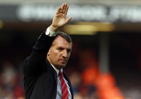 Liverpool's manager Brendan Rodgers waves following their final soccer match of the Premier League season against Newcastle United which they won 2-1, at Anfield in Liverpool