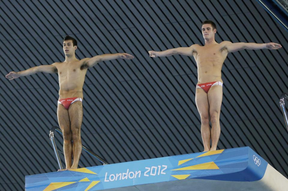 Bronze medalists Nicholas McCrory, left and David Boudia, right, from the US prepare to compete at the Men's Synchronized 10 Meter Platform Diving final at the Aquatics Centre in the Olympic Park during the 2012 Summer Olympics in London, Monday, July 30, 2012.(AP Photo/Lefteris Pitarakis)