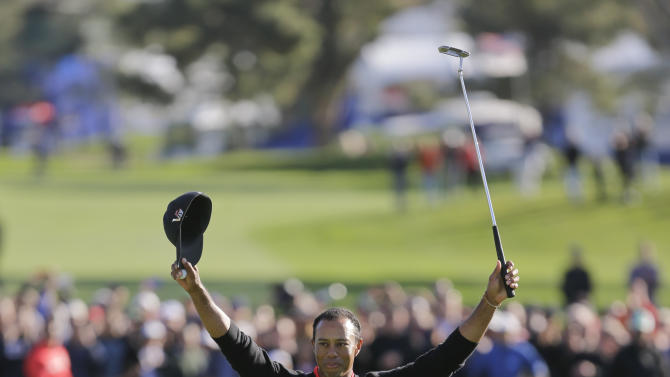 Tiger Woods celebrates after his victory in the Farmers Insurance Open golf tournament, Monday, Jan. 28, 2013, in San Diego. (AP Photo/Lenny Ignelzi)