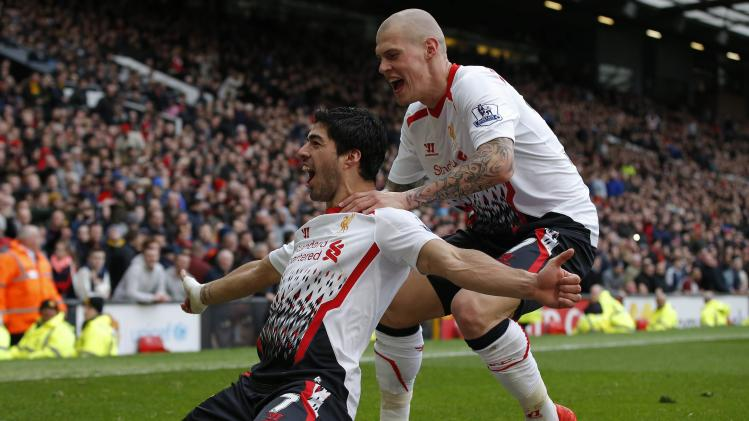 Liverpool's Suarez celebrates with Skrtel after scoring his side's third goal during their English Premier League soccer match against Manchester United at Old Trafford in Manchester