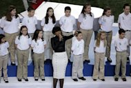 "Jennifer Hudson performs with students from Sandy Hook Elementary School singing ""America the Beautiful"" before the NFL Super Bowl XLVII football game between the San Francisco 49ers and the Baltimore Ravens, Sunday, Feb. 3, 2013, in New Orleans. (AP Photo/Gerald Herbert)"