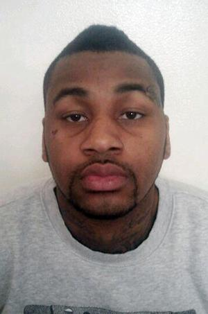 FILE - This undated photo released by the Las Vegas Metropolitan Police Department shows Ammar Harris following his Thursday Feb. 28, 2013 arrest in Los Angeles.  The son of the taxi driver killed in a fiery crash following a vehicle-to-vehicle shooting on the Las Vegas Strip has filed a negligence lawsuit against Harris, who is being held as a fugitive on Nevada homicide charges. (AP Photo/Las Vegas Metropolitan Police Department, File)