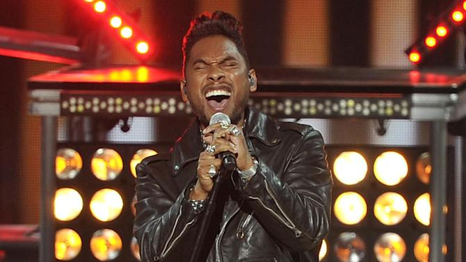 "FILE - This Thursday, Nov. 8, 2012 file photo shows singer Miguel performing at the Soul Train Awards at Planet Hollywood Resort and Casino in Las Vegas. Miguel is up for five Grammy Awards, including song of the year for his crossover hit, ""Adorn."" (Photo by Jeff Bottari/Invision/AP, file)"
