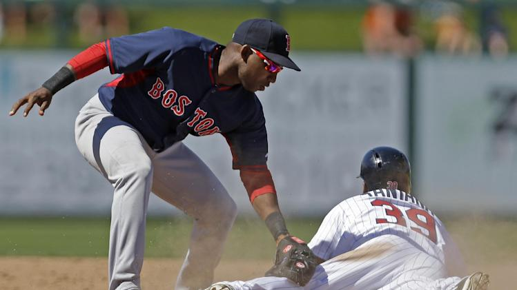 Minnesota Twins Danny Santana (39) steals second base as Boston Red Sox second baseman Jonathan Herrera (10) applies the late tag during an exhibition baseball game in Fort Myers, Fla., Thursday, March 13, 2014